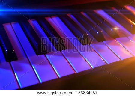 Keyboard Synthesizer With Colorful Lights In Concert