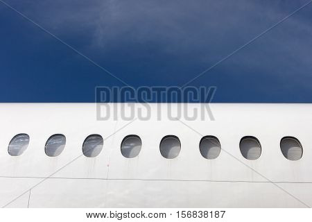 fuselage element with windows on a background of blue sky