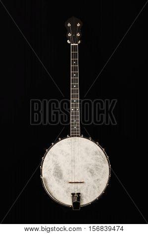 Open Banjo on black background, wooden carved
