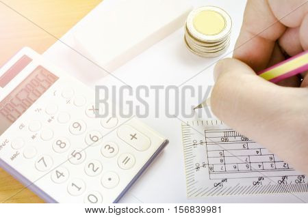 Business concept Hand writh something on blank paper .