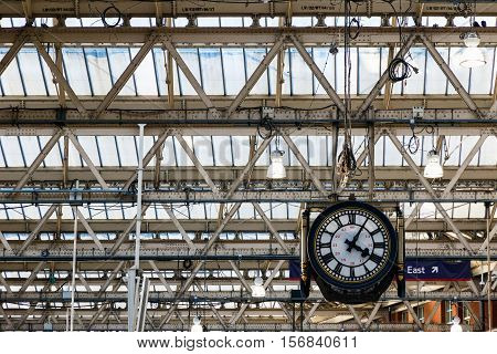 London UK - October 18 2016 - Hanging clock under the ceiling at Waterloo station in London