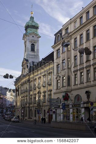 VIENNA, AUSTRIA - DECEMBER 31 2015: Landstrasse street in Vienna with Elisabeth hospital belltower in the backgrund