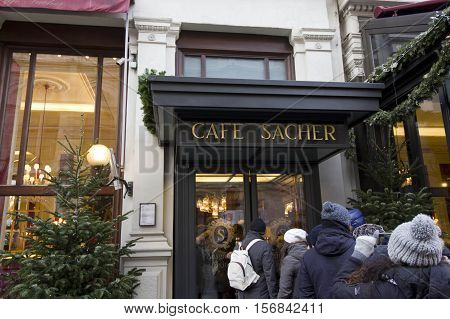 VIENNA, AUSTRIA - DECEMBER 31 2015: Entrance of Cafe Sacher Hotel in Vienna with people in queue