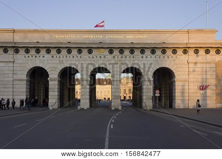 VIENNA, AUSTRIA - DECEMBER 31 2015: burgtor castle gate in Vienna at day time with people around
