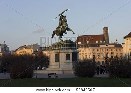 VIENNA, AUSTRIA - DECEMBER 31 2015: Heroes square in Hofburg Palace in Vienna equestrian statue of Archduke Charles at sunset light