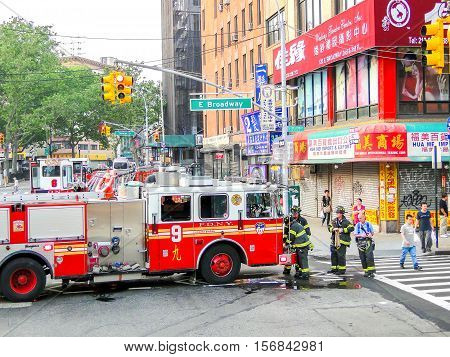 New York USA June 2 2011: FDNY firefighters at work in Chinatown East Manhattan