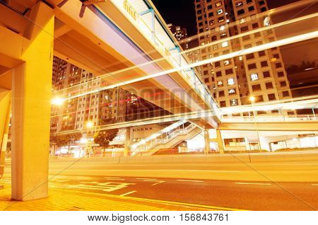 The light trails on the modern building background in Hong Kong china.