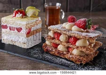 cream cake  strawberry frosting mille feuille dessert sweet on black stone