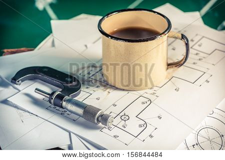 Micrometers, Mechanical Diagrams And A Cup Of Coffee