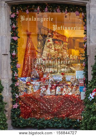 Colmar,France- December 62013: A window of a traditional Alsatian bakery is festive decorated during the winter holidays season.