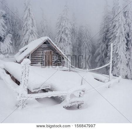 Great view of the alpine hut covered with snow. Apartment Santa Claus. Picturesque and gorgeous wintry scene. Location place Carpathian national park, Ukraine, Europe. Beauty world. Happy New Year!