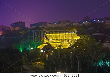 China, Qingzhou City, 5000 years of civilization history. Gold colored glazed tile, in the night is very beautiful