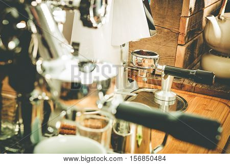 Coffee Making Equipment Closeup Photo. Elegant Shiny Coffee Maker and Grider
