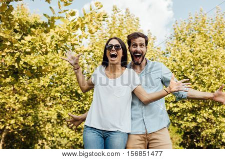 Happy And Surprised Couple Outside In Park