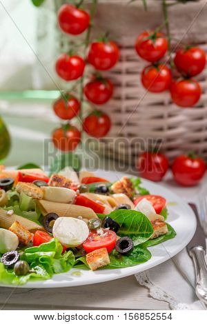 Spring Salad With Pasta On Old Wooden Table
