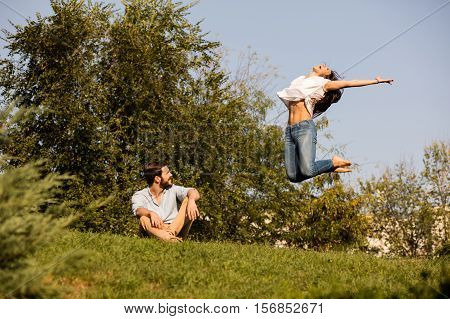 Woman Jumping Up Next To Her Lover With Joy