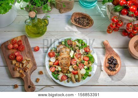 Caesar Salad Prepared In Spring Time On Old Wooden Table
