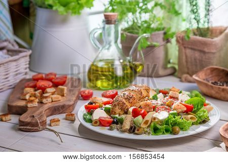 Spring Salad In The Sunny Kitchen On Old Wooden Table