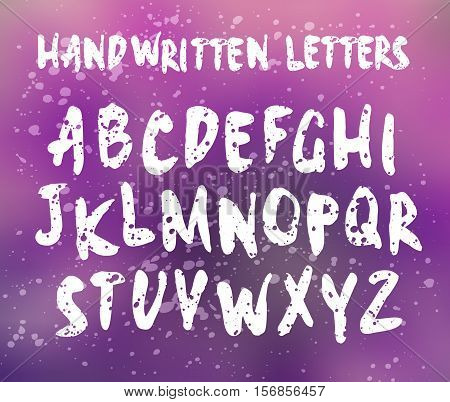 Vector handwritten letters. Sans serif. Uppercase letters. Doodle type and splatter texture. White print on blurred background