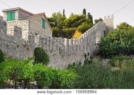 Detail of Hvar town walls in Croatia