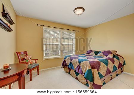 Kids Bedroom With Colorful Bed  And Pastel Yellow Walls.