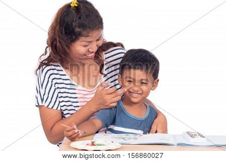 Mother tease her son while doing homework