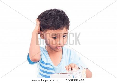 Cute child asian little boy scratching head