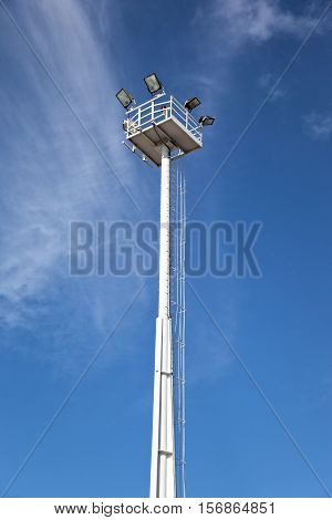 Lighting tower against a clear blue sky.