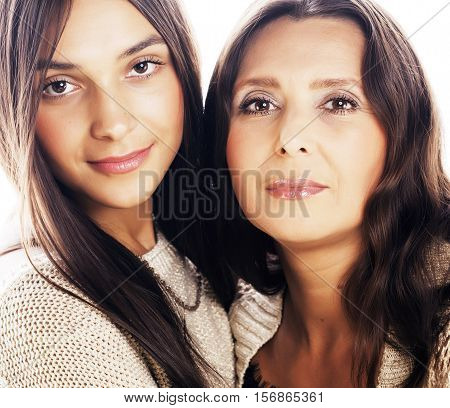 cute pretty teen daughter with mature mother hugging, fashion style brunette makeup close up tann mulattos, warm colors isolated