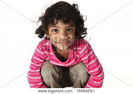portrait of little Indian girl on a white background