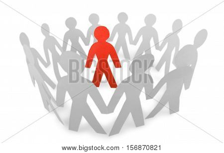 Paper People Standing in a Circle and One Red Paper Man Inside