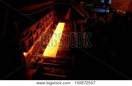 Sheet of hot metal on the conveyor belt from oven