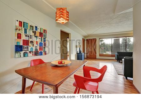 Dining Area Interior With Red Chairs And Apples On The Table.