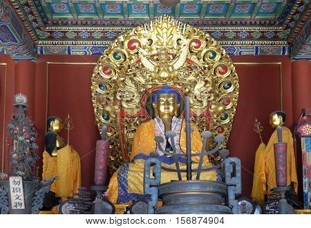 BEIJING - FEBRUARY 25: Blue Buddha Altar Offerings Yonghe Gong Buddhist Lama Temple. Built in 1694, Yonghe Gong is the largest Buddhist Temple in Beijing, China, February 25, 2016.