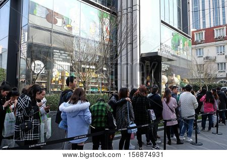 SHANGHAI - FEBRUARY 27: Teenagers waiting in line to enter the Line Friends cafe and shop in Shanghai, China, February 27, 2016.