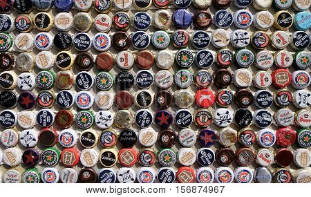 SHANGHAI - FEBRUARY 27, 2016: Beer bottle caps collection. Beer sales in China rose 29 percent between 2006 and 2011 to 50 billion liters, more than double the consumption in the US.