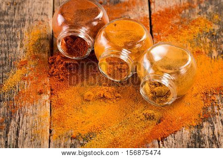 Spice. Various Spices Over Wooden Background. Paprika, Turmeric, Curry