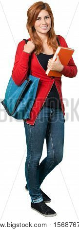 Redheaded woman carrying a tote bag and a textbook