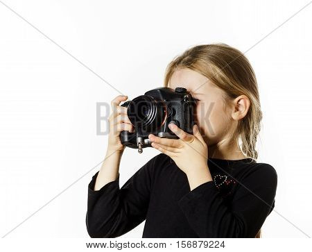 Little Girl Taking Pictures By Professional Digital Camera