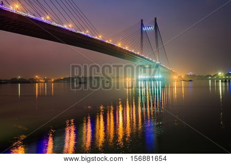 Vidyasagar setu (bridge) on river Hooghly at twilight time in city light illumination. Also known as the Second Hooghly bridge it is the longest cable stayed bridge in India.