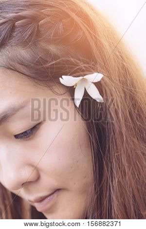 Young Hipster Woman, Chinese Women In Thiking Someting At The Prak With Withe Flower On Hair And Fre