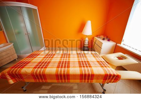 Room with table for massage, aromatherapy, relaxation and shower cabin