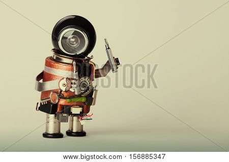 Repair service concept. Vintage style robot handyman with screwdriver. Fun toy character black helmet head. gradient background macro view copy space