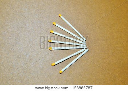 matches lined fan on a brown background