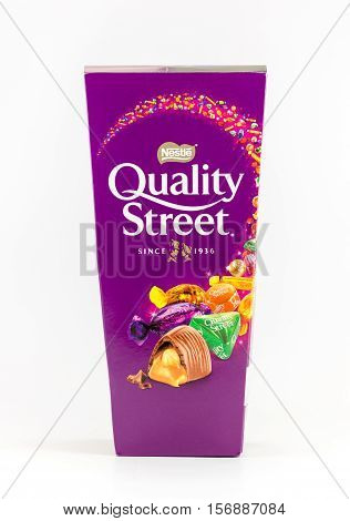 WREXHAM UK - OCTOBER 27 2016: Tapered box of Quality Street chocolate sweets on a white background.