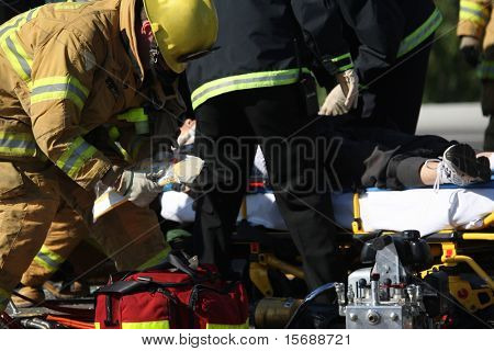 Emergency crew removing a victim from a car accident