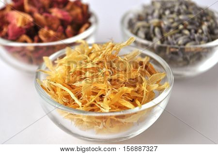 Dried petals of rose with marigold and lavender front view