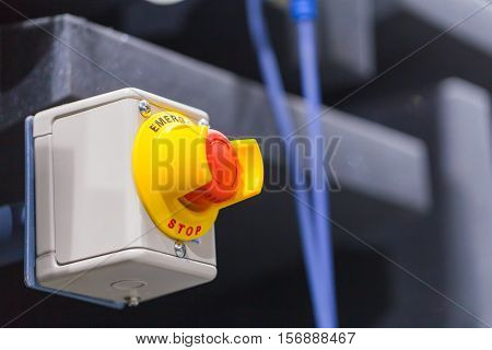 The red emergency button or stop button for Hand press. STOP Button for industrial machine Emergency Stop for Safety.