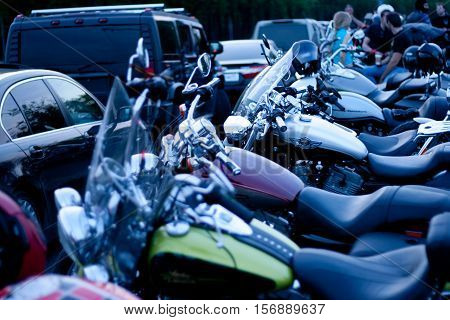 MOSCOW RUSSIA - OCTOBER 6 2013: Motorcycles parked in a row on the viewing platform Vorobyovy Gory near Moscow State University named after Lomonosov. This place is popular for meetings in Moscow bikers on weekends.