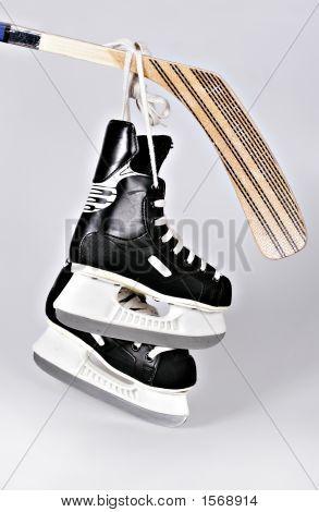 Hokey Skates And Stick